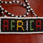 African culture & genuine evangelism - Beaded Africa on a dark red surface