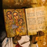 Fathers of the Reformation: Illuminated Ethiopian Bible held by an African