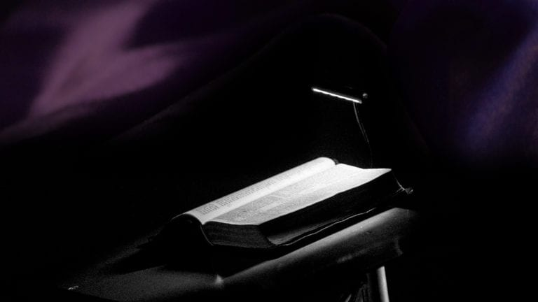Can I speak against the lord's anointed? A lectern and open bible in a dark space