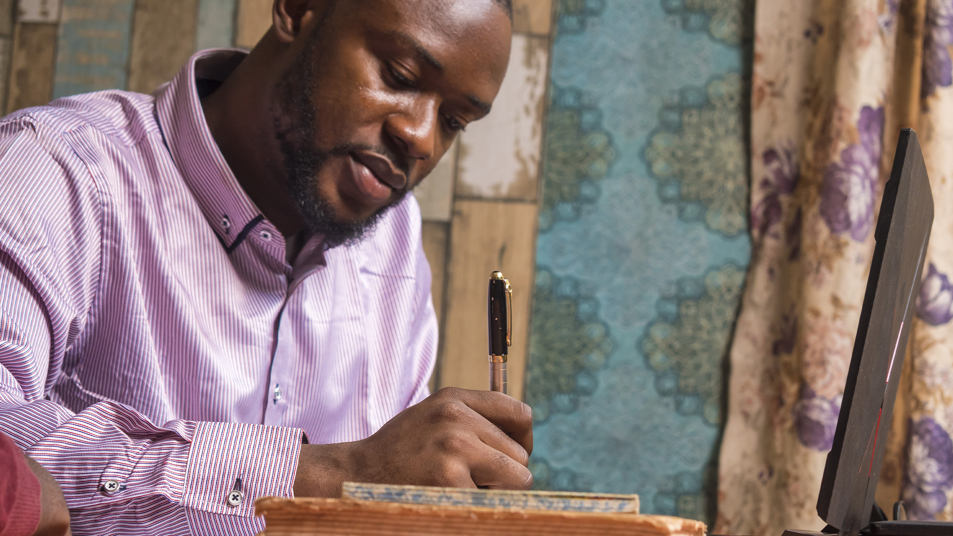 Formal church membership is important in Africa - African pastor writing a list