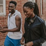 Christian Dating FAQs image of African young couple in a street