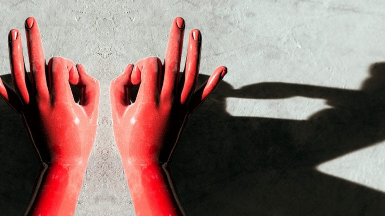Deliverance Ministry - learning from Jesus - two red hands making a perfect sign, with a shadow behind