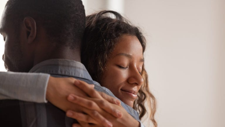 The one lesson you need for a peaceful marriage - African couple hugging happily