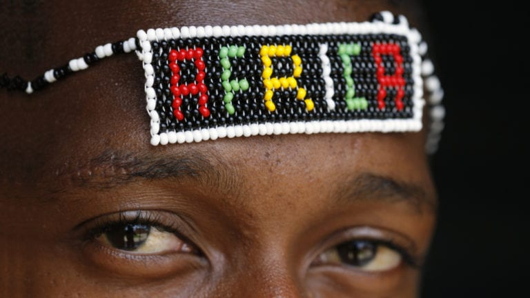 Why Isn't African Christianity impacting African Society? African man with beaded Africa headband