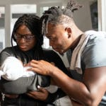 Young African Parents with their baby in a modern apartment