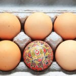 Different on the outside - one painted egg in a tray of hen's eggs