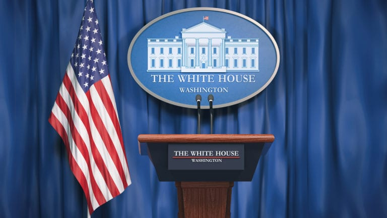 American Politics - Why are we so obsessed? Image of White House press conference podium