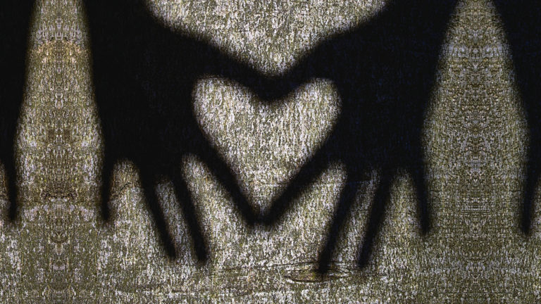 Exorcism and the role of the church - hands making a heart