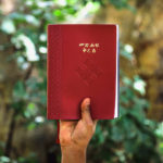 Reconciliation in Ethiopia - A hand holding an Ethiopian bible up