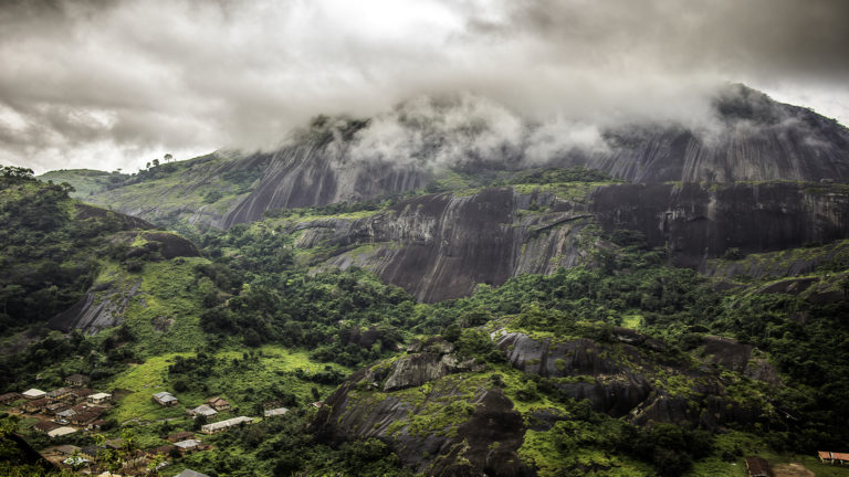 God's Sovereignty - A big mountain with cloudy overcast clouds on the top of the mountain.