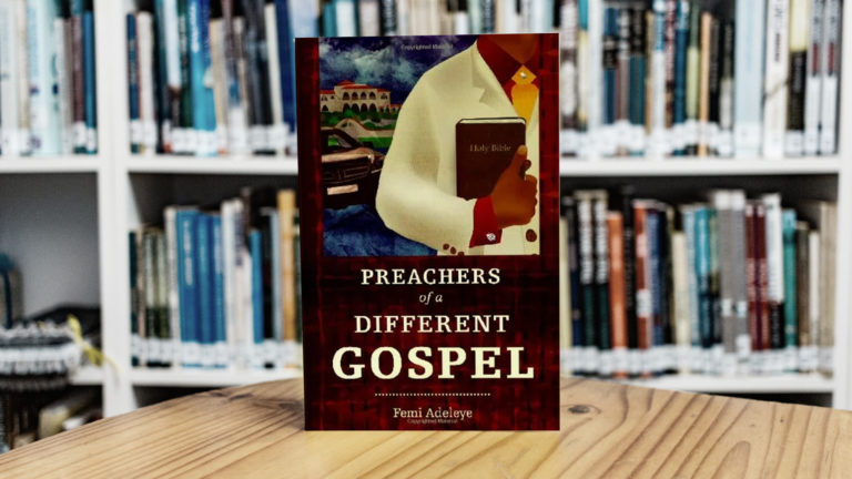 Prosperity Gospel - Book standing on a table table with many other books on shelves in the background.