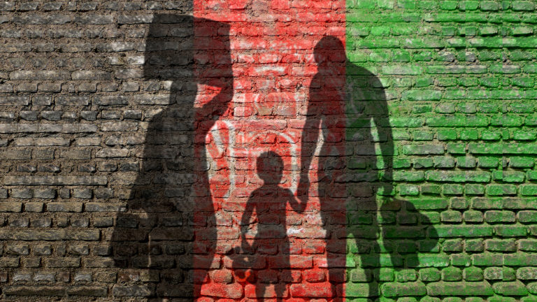 Christian response to refugees - Flag of Afghanistan with silhoutte of a man, woman and child on the flag.