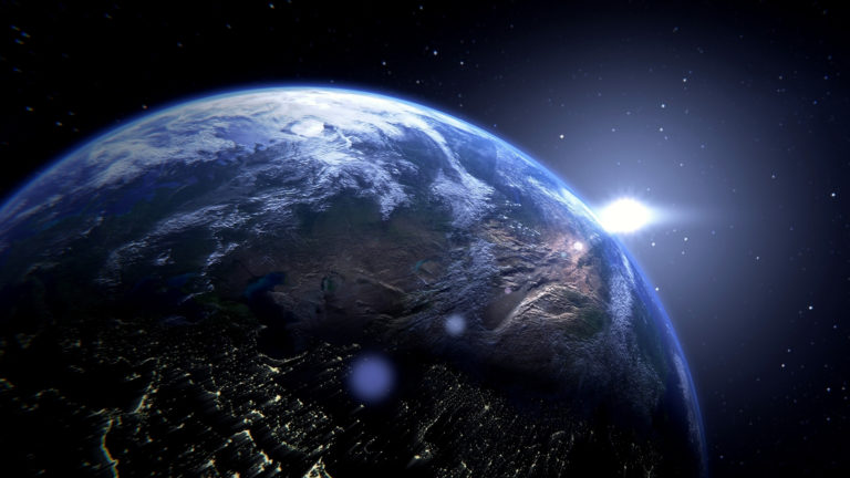 Who Created God? Planet Earth with the sun behind it