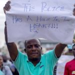 Police Corruption - People marching against police corruption on the streets