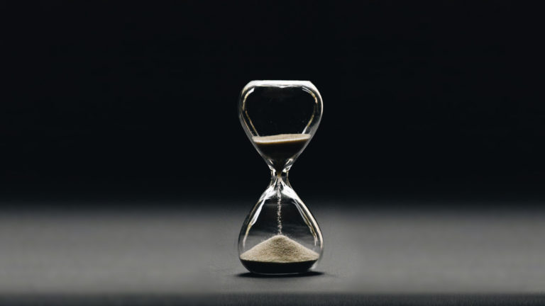 Waiting on God - A hourglass, with sand falling to the bottom