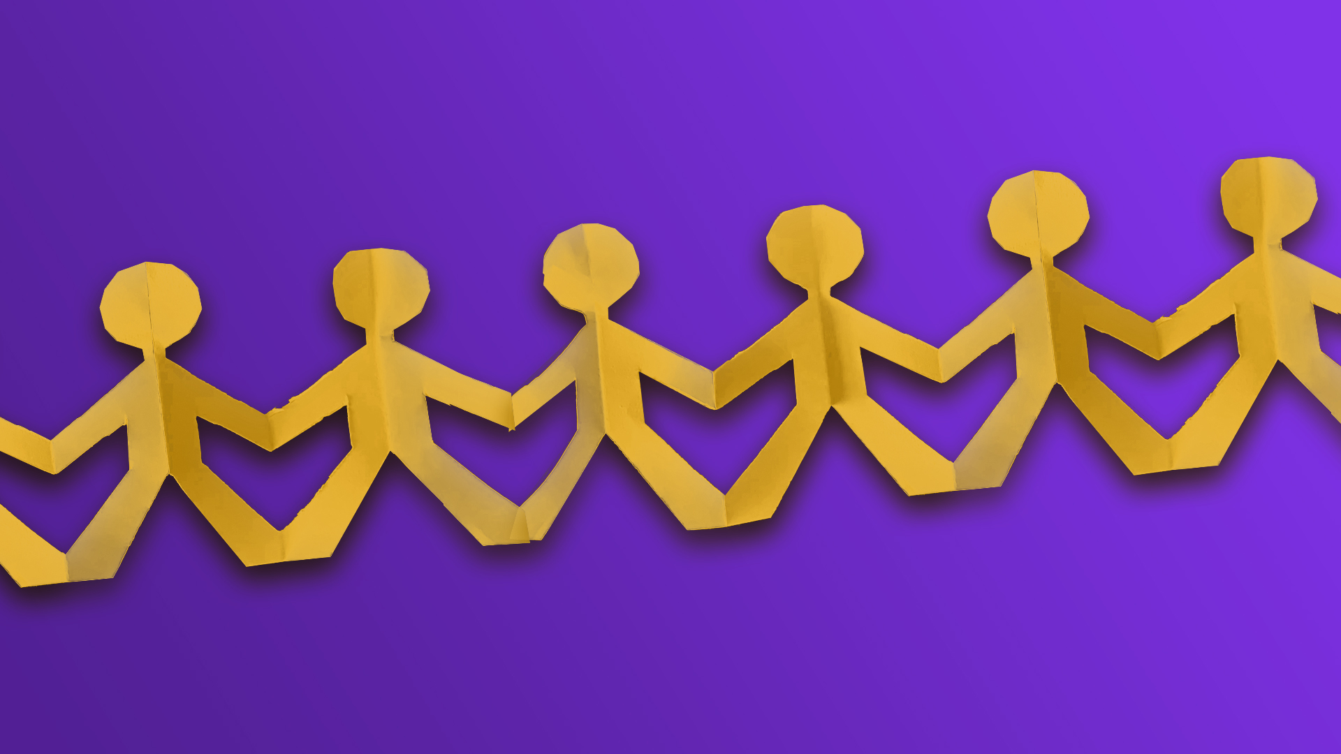 Friendship - Yellow cut out paper men holding hands on purple background