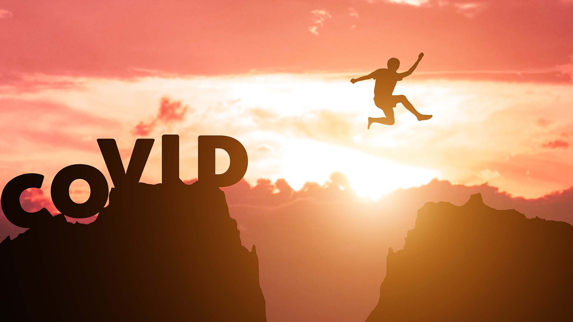 Perseverance - A silhouette of a person jumping from one mountain peak to another with a sunset in the background