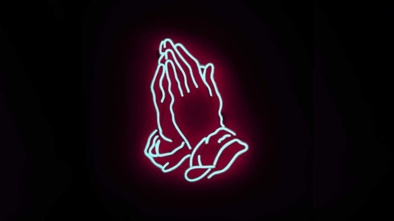 Being faithful in prayer - praying hands with a glowing outline on a dark background